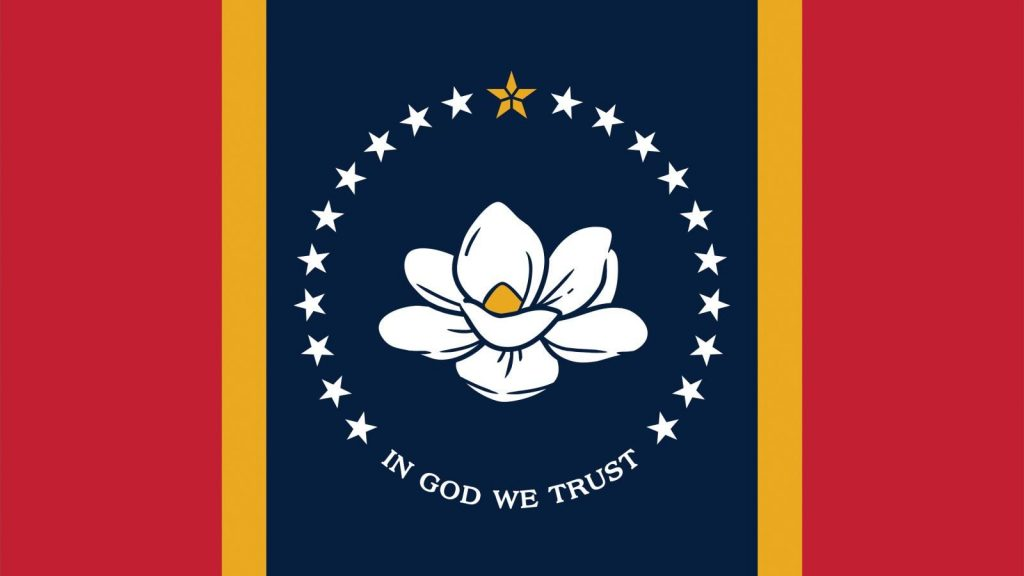 A close up of the Mississippi state flag featuring a white magnolia