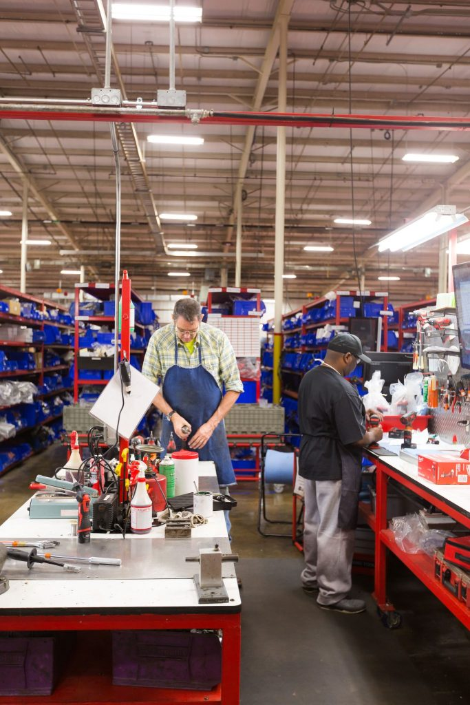 Two employees work inside a Milwaukee Tool facility in Mississippi